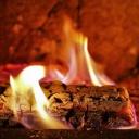 Krbová kamna jako magická dominanta obývacího pokoje